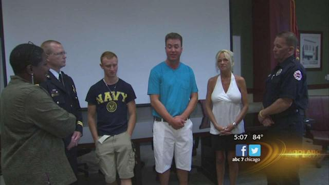 Firefighters meet couple rescued from floodwaters