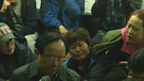 Raw: Angry Relatives Confront SKorea Officials