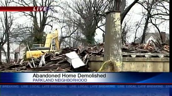 Neighbors happy to have abandoned home torn down