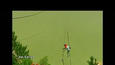 Chinese tightrope walker survives high-wire fall