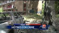 Burned cars litter blighted Algiers complex