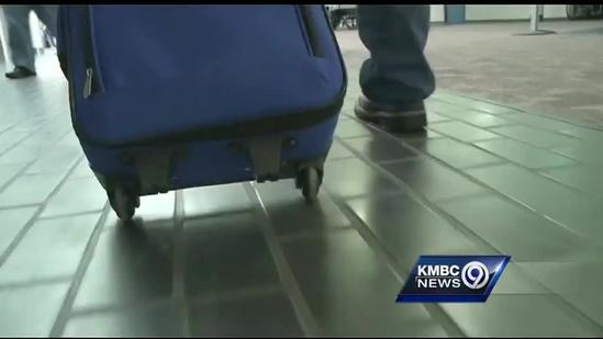 Family awaits military parent's return to KCI