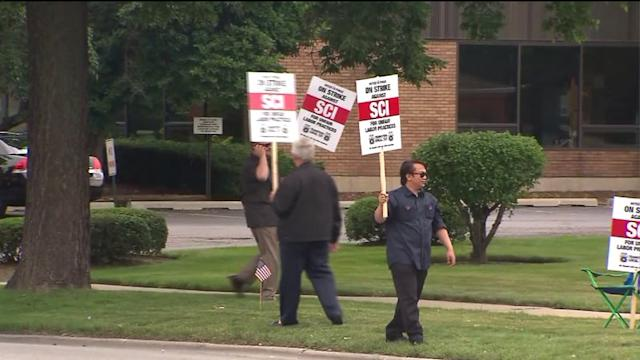 Funeral home directors and drivers strike over labor dispute