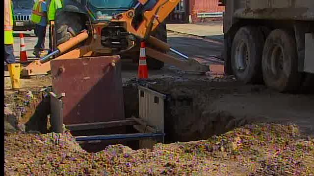 Noon: SUV ends up in sinkhole