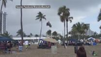 WEB EXTRA: Beach Goer Video Tapes Waterspout Flinging Bounce House