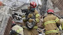 Woman Rescued From Underneath Rubble in Collapsed Building
