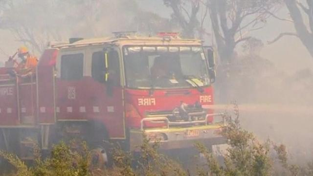 Australian firefighters race to contain wildfires