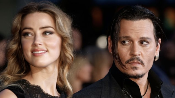 1214e5c10 Amber Heard says she was abused by Johnny Depp for years