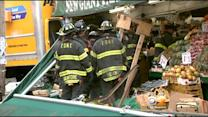 Students Shaken After School Bus Hits Truck, Leads To Crash Into Queens Fruit Store