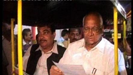 Speculation erupts after Pawar shares auto with Gadkari