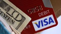 Visa weighing on Dow, Starbucks losing steam, Pandora plummeting