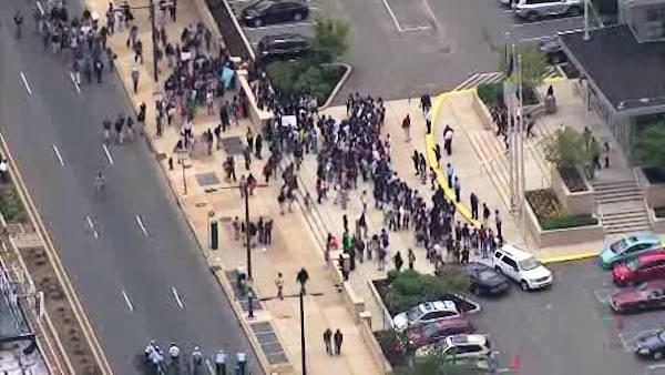 Students walk out of class, stage protest march on Broad Street