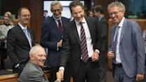 Greece Reaches Debt Deal With Eurozone, IMF