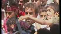 Desperate Yazidis mob helicopter in dramatic rescue mission