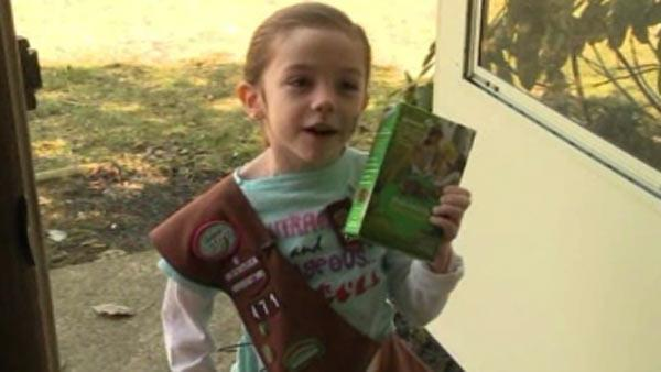 Girl Scout collects cookies for troops