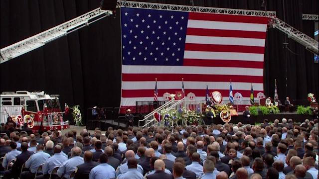 Thousands fill Reliant to mourn fallen Houston firefighters