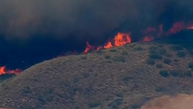 Firefighters battle raging San Diego wildfires