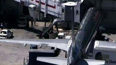 Raw Video: Unruly passenger restrained in Miami