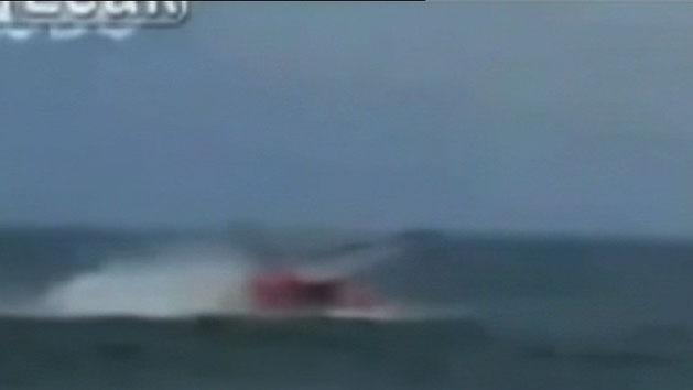 Chopper crashes into ocean