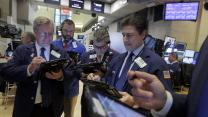Markets up modestly ahead of short trading week