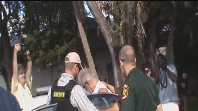Pastor Terry Jones' congregation says he was arrested over gas soaked qurans