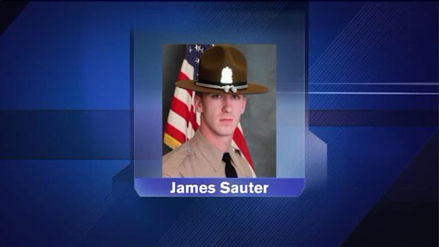 Trucker charged with accident that killed Illinois state trooper
