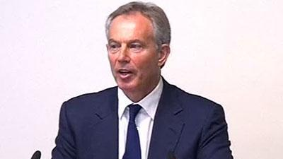 Raw Video: Heckler bursts in on Blair testimony