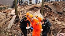 Around the World: Landslide buries village in China