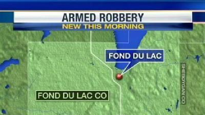 Police Search For Loan Store Robbers