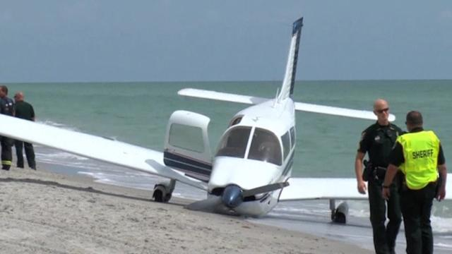 Plane crash kills man walking on beach