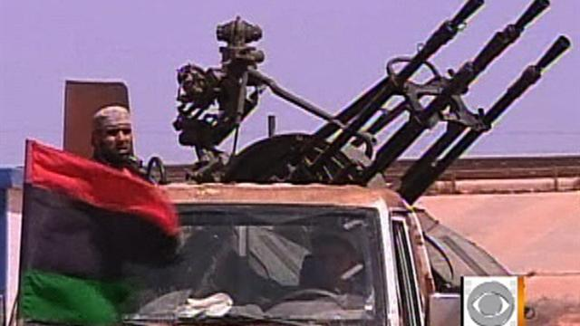 Qaddafi's sons offer mixed messages to rebels