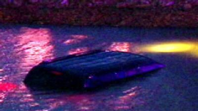 SUV Crashes Into Pond Near Airport