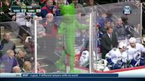 Green Bear dances in front of Canucks bench