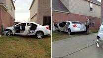 Suspect flees after crashing car into house