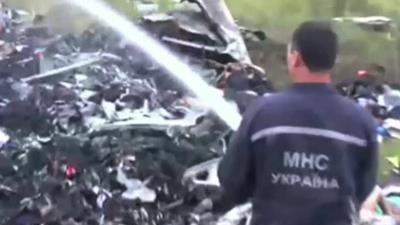 Raw: Firefighters Locate Malaysian Jet Wreckage