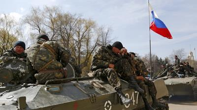 Combat Vehicles in East Ukraine Fly Russian Flag