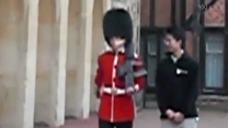 Tourist finds himself looking down the barrel of a Queen's Guard's rifle