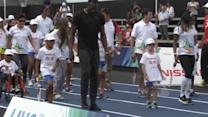 Usain Bolt dances the samba with Rio's youth