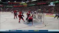RJ Umberger bats the puck past Anderson