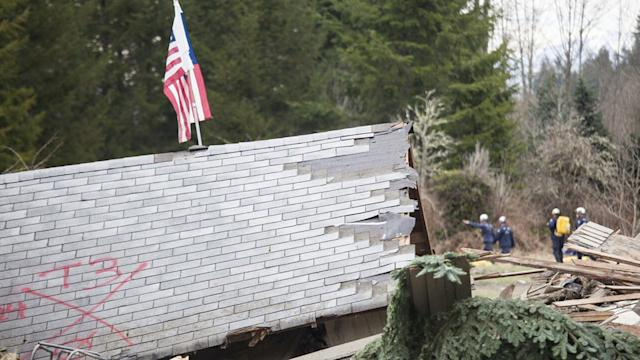 DIGGING FOR VICTIMS OF WA SLIDE